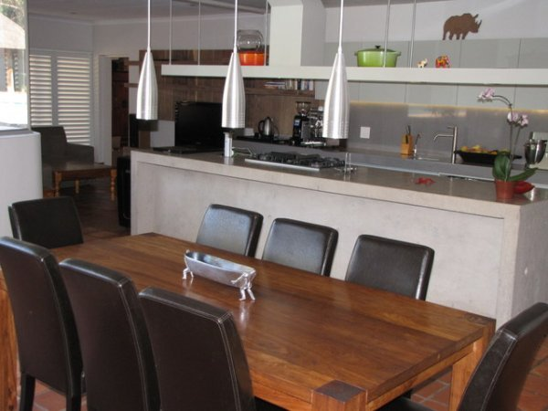a stunning flow from dining room to kitchen