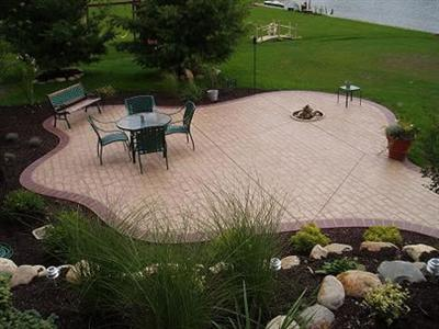 Concrete Offers Much More Than Just A Bland Slab, As This Photo Clearly  Shows. It Blends Perfectly Between The Fish Pond On The Left And The Lawn  That ...