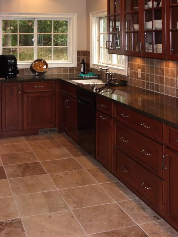 rustic kitchen with rich colours, earthy textures and natural finishes like granite, and copper to bring balance